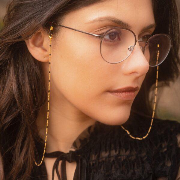 Chaine de lunettes dorée à perles noires