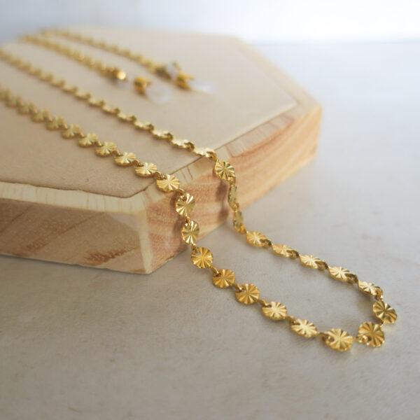 Chaine de lunettes dorée à sequins pour femme